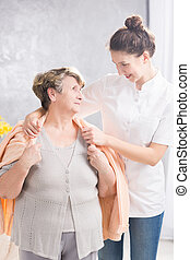 Covering with sweater - Professional caregiver covering...