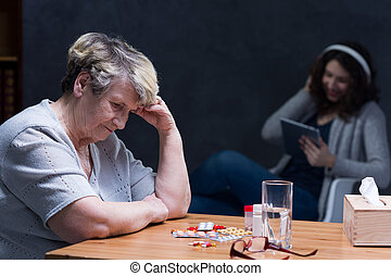 Broken senior woman - Broken elderly woman and uninterested...