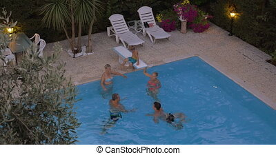 Family bathing in the swimming pool
