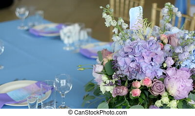 arrangement of different flowers of different colors, standing on tables for a holiday decoration