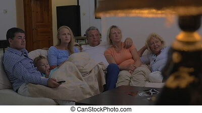 Family watching movie together - Big family spending evening...