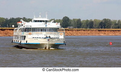 passenger ship floating in the river