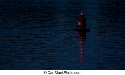 flashing buoy on the river at dusk