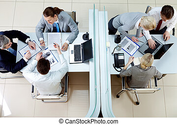 Business meeting - Above view of two groups of people...