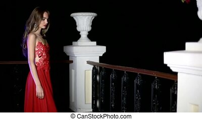 Beautiful girl in a red dress on the balcony HD