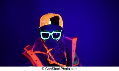 Guy dancing in neon costume HD