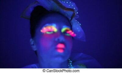 Close-up of a girl with neon face
