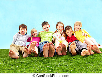 Relaxing children - Group of happy children relaxing on the...