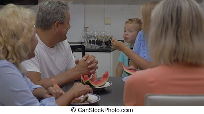 Child eating watermelon from mothers hands - Family eating...