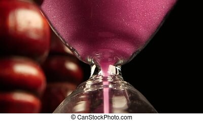 Hourglass Poured the sand in clock Close up - Pink sand...