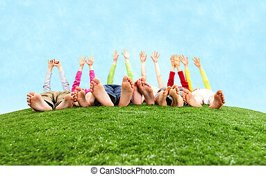 Funny game - Image of several children lying on the grass...