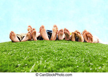 Resting on open air - Image of several legs lying on the...