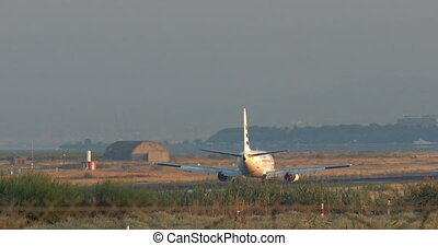 Plane on the landing strip - Airplane moving slowly along...