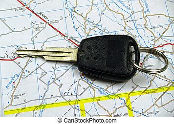 Car Key on Road Map - A single black car key sitting on a...