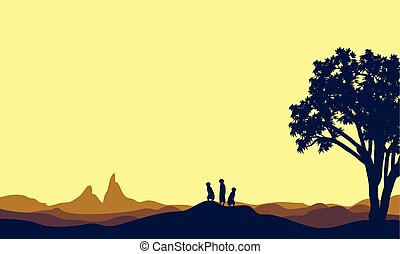 Meerkat at afternoon landscape silhouette beautiful vector