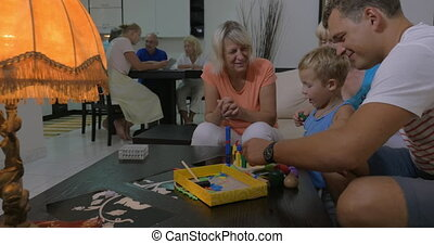 Family and child playing with construction toy - Child with...