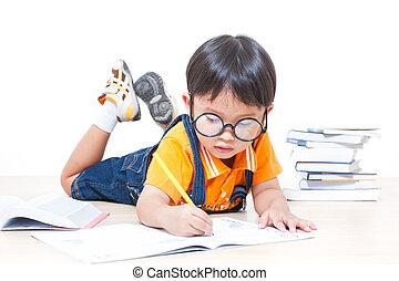 boy writing homework - cute boy writing homework from school...