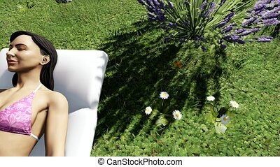 Young woman lying in the grass and relaxing
