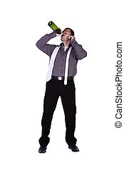 Businessman drinking straight out of the bottle