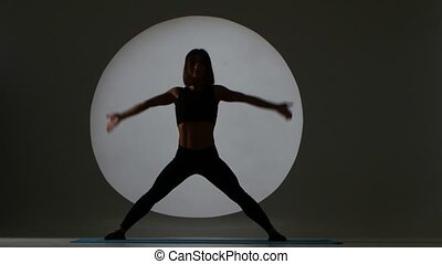 Athlete does pose mountain. Back light. Silhouette - Athlete...