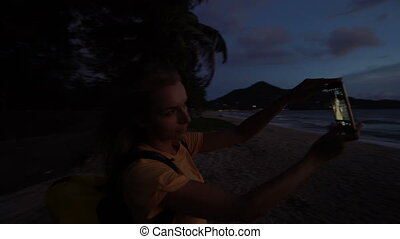 Woman taking selfie on the sunset.
