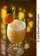 Apricot Colada - A Colada cocktail with a slice of an...