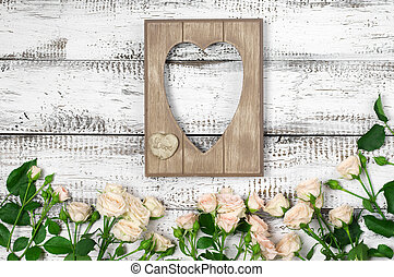Wooden heart shape frame with roses - Empty vintage wooden...