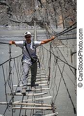 Crossing dangerous bridge