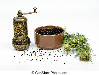 black cumin - cumin and mill on white background