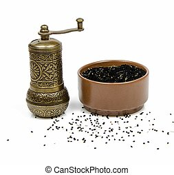 black cumin and mill on white background