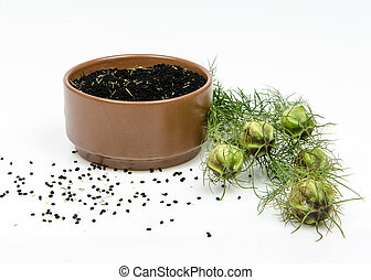 black cumin in bowl on white background