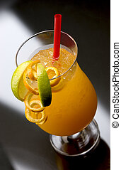 Typical Hurricane Longdrink with orange, lime and red straw