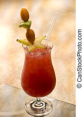 Hurricane Mocktail with straw and fruits