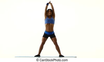 Woman tilts her body White - Fitness woman tilts her body,...