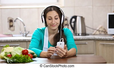 girl in headphones listens to music