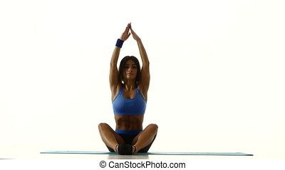 Gymnast sitting in lotus position and goes into the splits...
