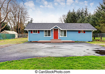 Simple one story house exterior with blue and red trim -...