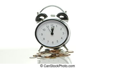Alarm clock and coins Close up - Alarm clock and coins,...