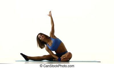 Gymnast sitting in lotus position and goes into the splits....