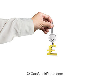 Hand holding silver key with golden pound symbol shape keyring