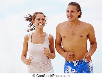 Running couple - Photo of fit and healthy couple running on...
