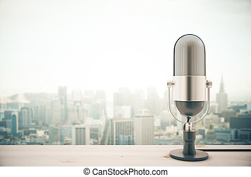 Mic on city background - Light wooden surface with...