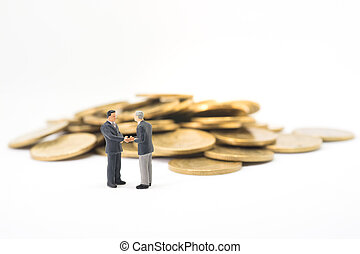 Startup business concept. Businessman handshaking with pile...