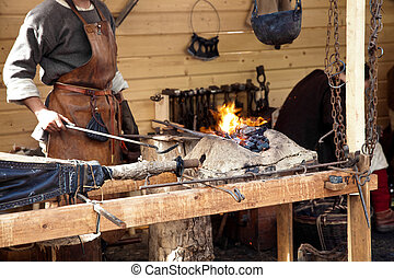 Blacksmith blows the bellows - The annual festival in...