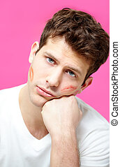 Confusion - Handsome man with print of lipstick on his cheek...