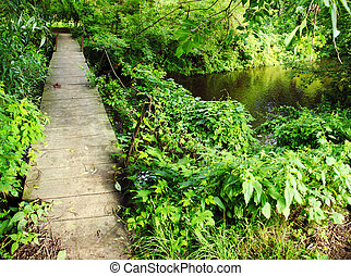panoramic image of an old wooden bridge