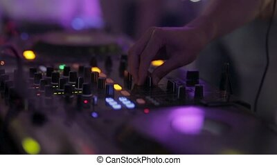 DJ mixer at the disco in the night club