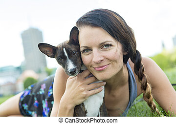 girl with a dog in the park