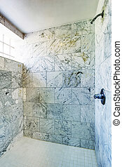 Bathroom interior Shower cabin with marble tile and small...