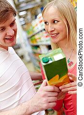 Choosing healthy food - Portrait of female looking at...